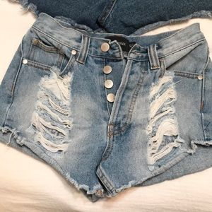 light wash distressed cut off jean shorts